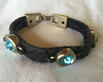 Black textured bracelet with three aqua blue gemstones