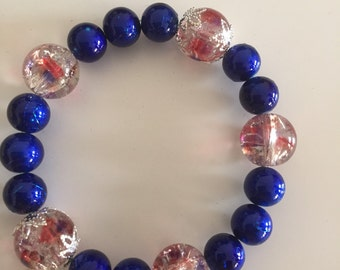 Blue and clear speckled bead bracelet
