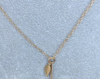 "18"" 14k gold chain w/14k gold bar & leaf charms"