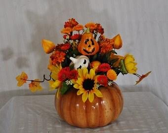 Halloween floral arrangement, pumpkin halloween arrangement, orange and yellow fall arrangement, jack o' lantern table arrangement