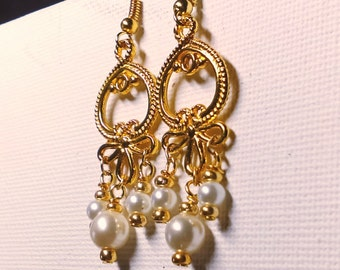 Pearls and gold chandelier earrigs