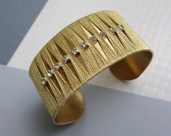 Cufflinks brass, embroidery thread gold and crystals