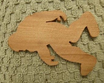 Redwood Bigfoot silhouette hand cut from reclaimed old growth stump in Humboldt California