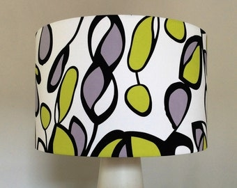 Handmade lampshade using fun,bold, abstract design in lime green, black and grey on white background
