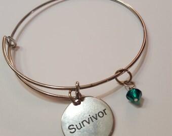 Survivor with May/ emerald crystal