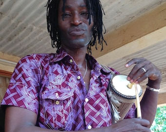 Tamà, talking drum, talking drum in West africa, traditional African instrument, African percussions, African music, griots