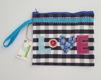 Zipper pouch, wristlet, toiletry bag, applique