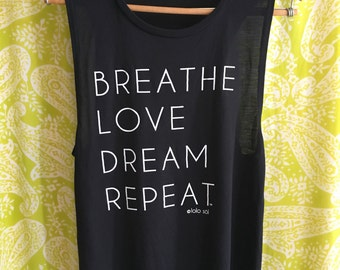 2.5 Solid Black Muscle Tank. Eco-Friendly. Yoga. Zen. Chill. Fitness. Festival. Wanderlust. Breathe. Love. Dream.