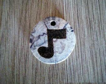 Rustic wood burned pendant. Musical note design.