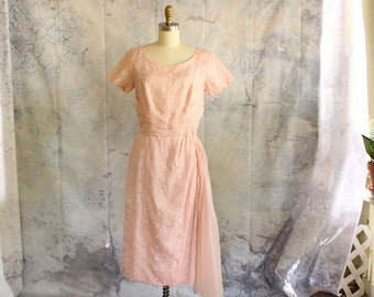 vintage 1960s pink cocktail dress by DuBarry . floral lace wiggle dress with long sash, hip swag . lace cutout dress, womens small