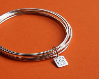 Five bangles linked with a charm handmade in Sterling Silver - Reminder - The value of recycling