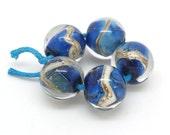 Handmade glass bead set SRA. Reactive blue glass beads.