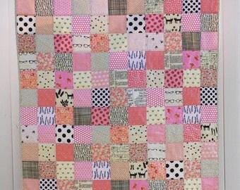 Pink and neutrals patchwork crib quilt