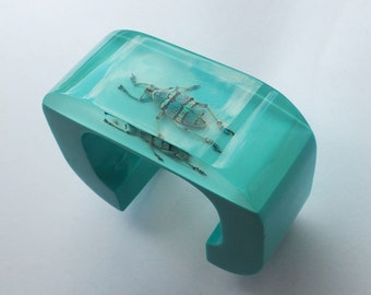 Large blue lucite cuff bracelet with real iridescent insect