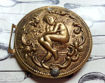 Cherub. Half Antique Buckle, Pressed Metal. As Found.