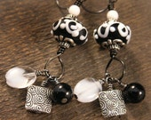 Black and white lamp work glass beads, silver charm handmade earrings