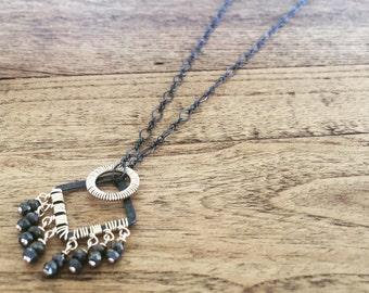 Mixed metal necklace with pyrite stones, 14k gold fill and oxidized silver pendant necklace.