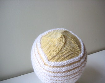 yellow and white knit hat