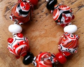 twisted....... lampwork bead set by Pixie Willow designs