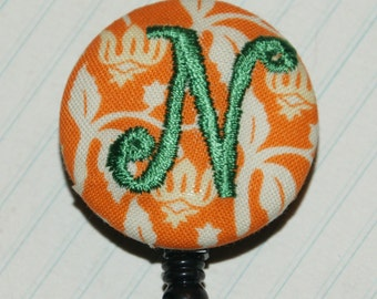 Many fabrics to design YOUR Badge Reel. Monogrammed single letter, #134