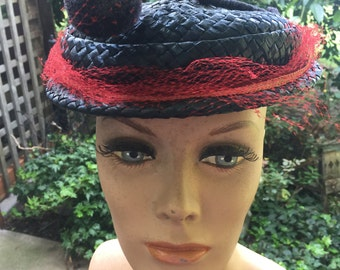 Vintage Ladies' Stylish Black Straw Hat with Red Netted Veil and Black and Red Pom Poms