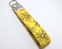 Keychain. Key fob.  Wristlet keychain.  Key wristlet.  Key holder.  Black sunburst on yellow polka dot fabric.