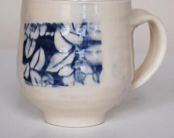 indented white mug