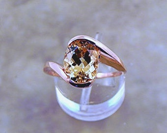 AAAA Natural Imperial Topaz Untreated   9x7mm  1.93 Carats   in 14K Rose gold ring  Also available in 18K gold. 1702