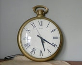 Vintage electric wall clock pocket watch gold white dial black numbers