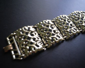 Runway vintage 70s blush gold tone metal  extra wide, filigree bracelet. Made by Judy Lee.Size7.