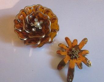 2 Orange flower brooches