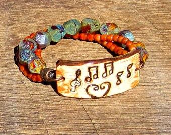 Musical Notes Triple Strand Bracelet rustic music musician treble clef boho brown orange yellow tan beige earth tone colors