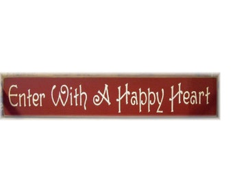 Enter with a happy heart primitive wood sign