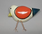 "Baby Bird with Red-Orange Wing-Hand built-Formed white stoneware clay-Twisted copper wire form legs & feet-8"" x 6"" x 2""-Painted underglazesl"