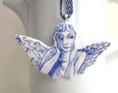 Serious Angel - Handformed and handpainted stoneware Delft ornament/wall hanging