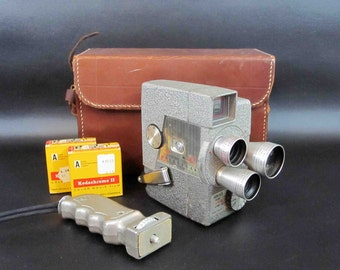 Vintage Wollensak  3 Lens 8mm Movie Camera with Case, Pistil Grip, and Un-used 8mm Film. Circa 1950's.