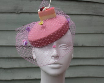 Dusky pink 'let them eat cake' pillbox hat with veil