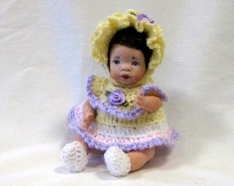 "Doll 5"" baby cast in porcelain from a vintage mold wearing a crocheted dress and hat"
