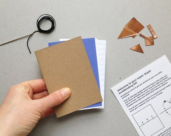 DIY bookbinding kit with paper, needle, thread and real copper stickers