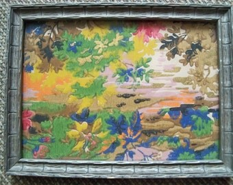 antique frame with  antique wallpaper sample inside