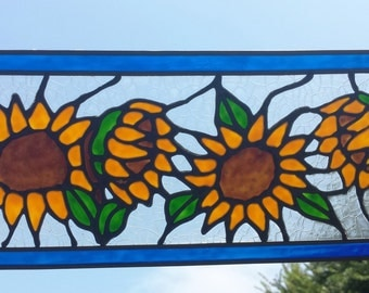4 Sunflowers stained glass window with blue framed