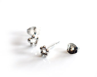 Small sterling silver circle studs , mini silver flower studs , seed studs handmade by Canadian Jewellery artist Melissa Pedersen