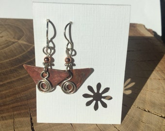 Reclaimed copper roofing earrings with fine silver swirled wire.