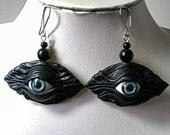 Black leather earrings with blue eye.  Evil eye leather earrings.  Halloween earrings. Dangle leather earrings.