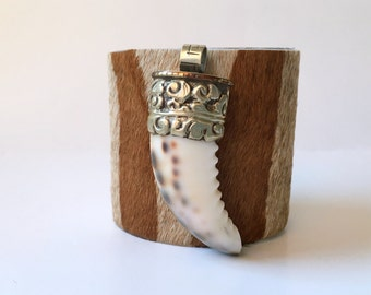 "leather cuff bracelet  - hair on hide with cowrie shell ""horn""  - 2.5"" wide"