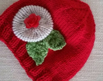 Hand knit hat with flowers