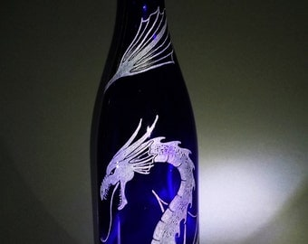 Freehand Engraved Dragon on a Recycled Blue Wine Bottle