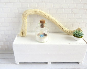 Terrarium bottle with seascape in shades of light blue in 1:12 scale