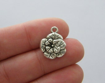 8 Flower charms antique silver tone F177