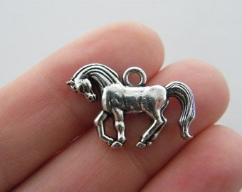4 Horse charms antique silver tone A13